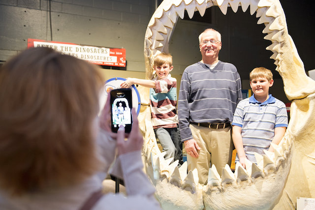 standing within the massive jaws of a megalodon shark