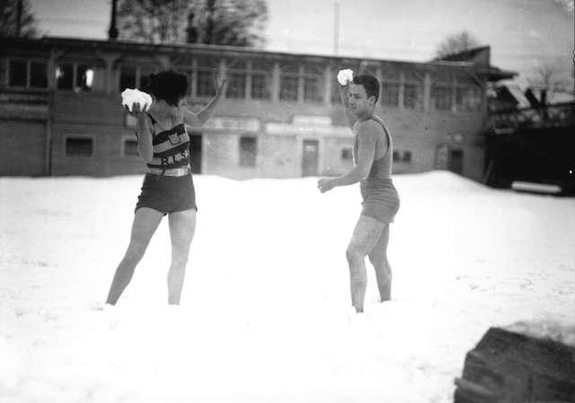 Miss E. Robinson and Pete Pantages, Royal Lifesaving Society members pose at snowy beach