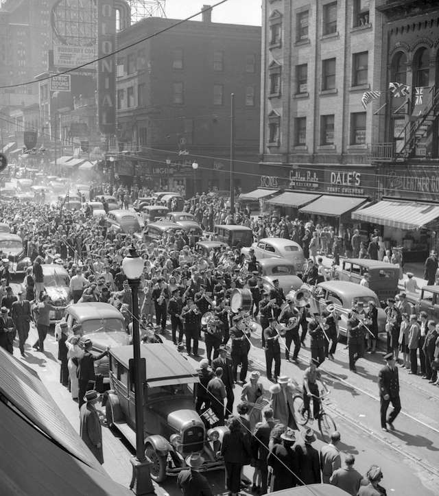 V-E Day in Vancouver. Crowds at Granville and Dunsmuir.