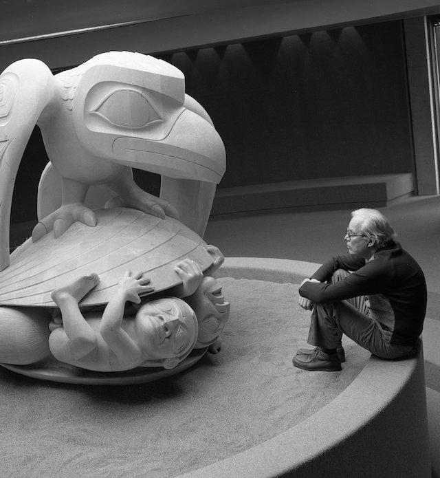 Bill Reid with his sculpture, Raven and the First Men, c.1980. Photo by Bill McLennan. Courtesy UBC Museum of Anthropology, Vancouver, Canada.
