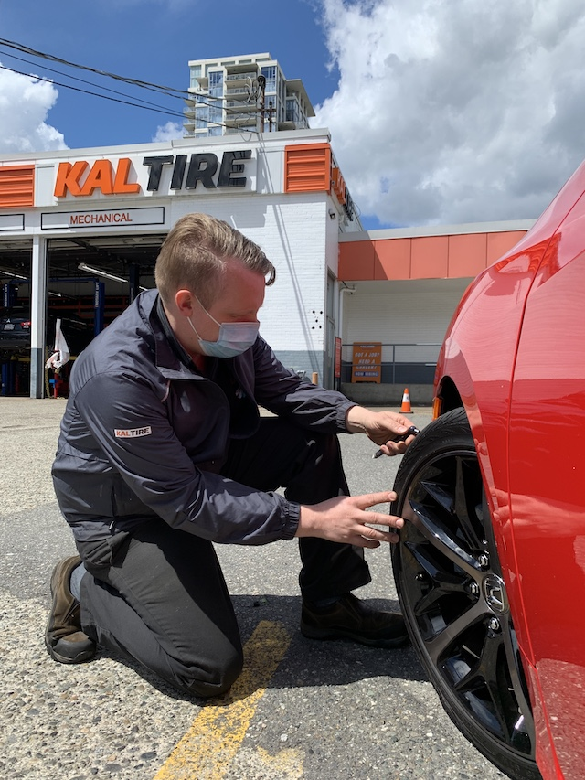Barrie checking tire depth at Kal Tire in New West